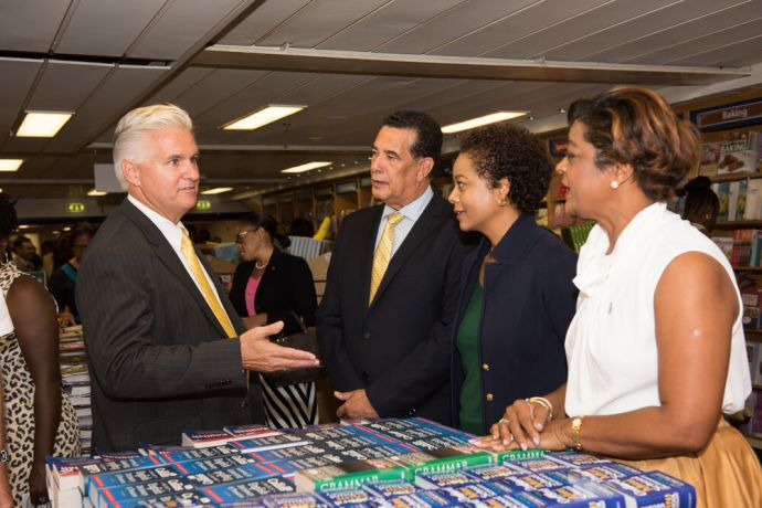 Jamaica: Montego Bay, Jamaica :: Acting Director Randy Grebe (USA) hosts Mayor Homer Davis and Custos Claudette Bryan in the bookfair. More Info