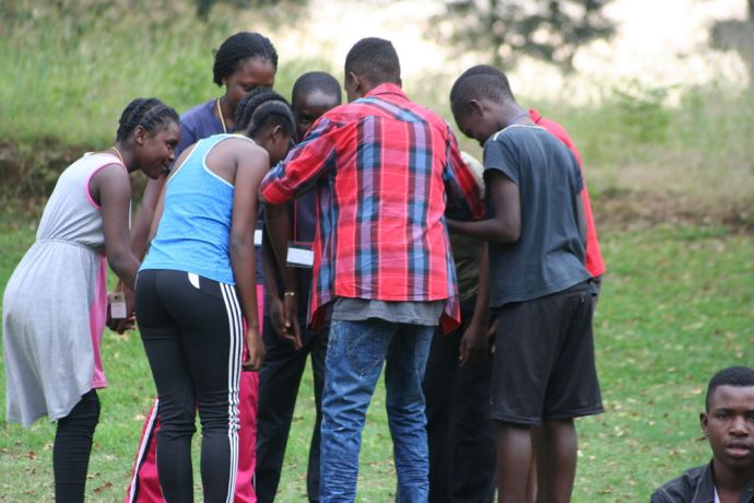 Zimbabwe: Youth Camp attendees discussing a point in a team building exercise More Info