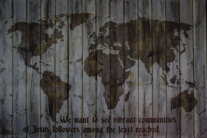 International: A wooden up-cycled map of the world hanging in OMs base in Moldova, with an inscription of OMs new mission statement: We want to see vibrant communities of Jesus followers among the least reached.  Photo by Garrett N. More Info
