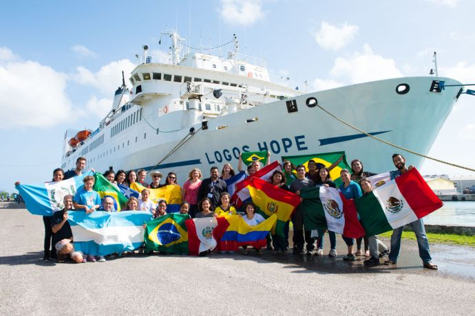 Jamaica: Montego Bay, Jamaica :: Crewmembers from Latin America with their flags at quayside. More Info