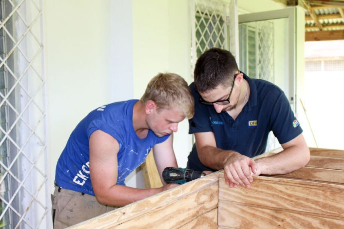 Jamaica: Montego Bay, Jamaica :: Simon Zoerb (Germany) and Job Ephraim (Netherlands) build a bookshelf for a library project. More Info