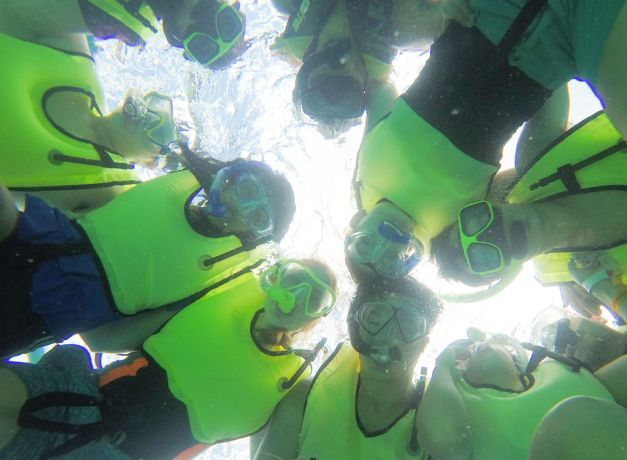 Bahamas: Nassau, The Bahamas :: Crewmembers snorkel together during an all-crew community outing to Blue Lagoon. More Info