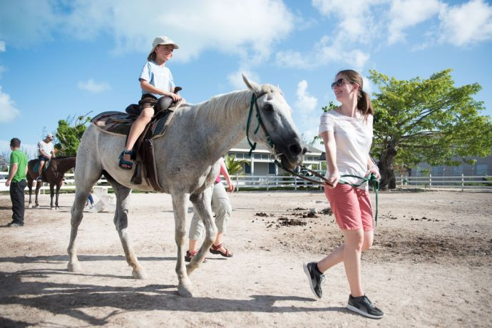 Bahamas: Nassau, The Bahamas :: Crewmembers ride a horse during an all-crew community outing at Adventure Learning Centre. More Info