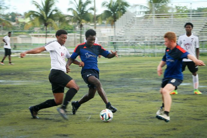 Bahamas: Nassau, The Bahamas :: Crewmembers play football against a local team in Nassau. More Info