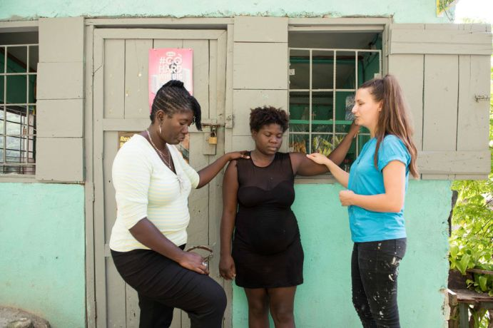 Jamaica: Montego Bay, Jamaica :: Viola Muck (Germany) and a YWAM volunteer pray for a woman while visiting a village. More Info