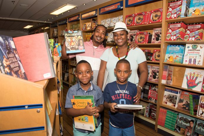 Bahamas: Nassau, The Bahamas :: Visitors pick out books in the bookfair. More Info