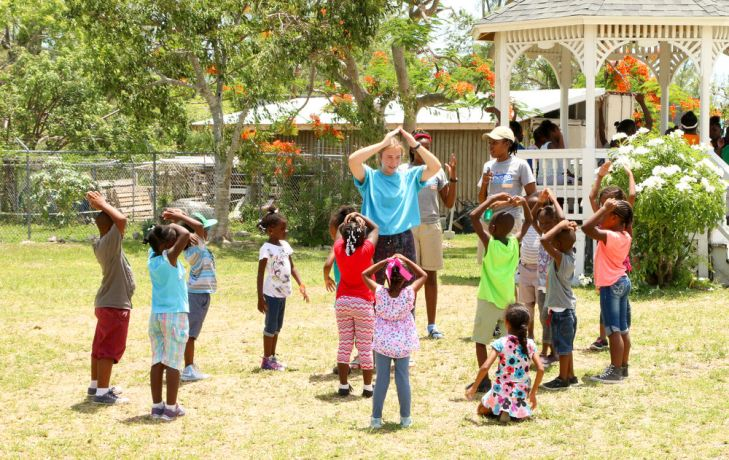 Bahamas: Nassau, The Bahamas :: Jenna Ballentine (UK) leads children in a group game at the Adventure Learning Centre. More Info