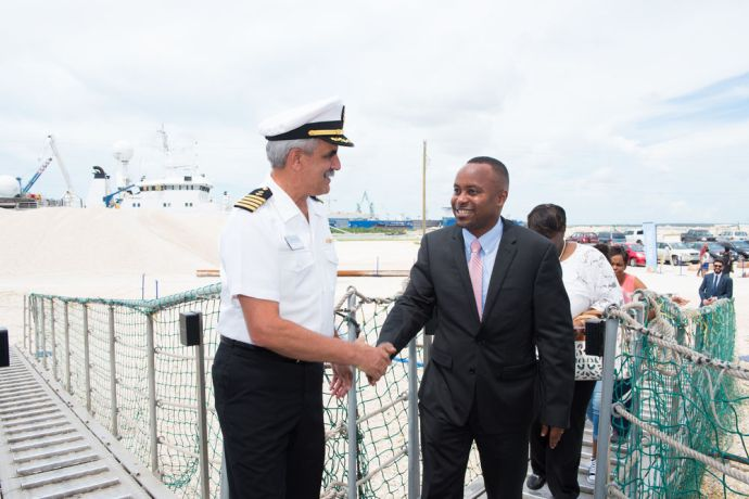 Bahamas: Freeport, The Bahamas :: Captain Pat Tracy (USA) welcomes Senator J. Kwasi Thompson, Minister of State for Grand Bahama. More Info