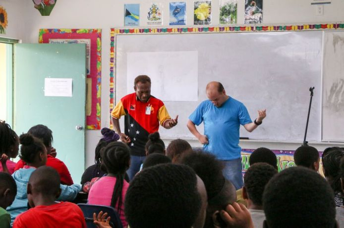 Bahamas: Freeport, The Bahamas :: Collin Kepas (Papua New Guinea) and Nate Johnson (USA) perform a drama during a visit to a police summer camp for children. More Info