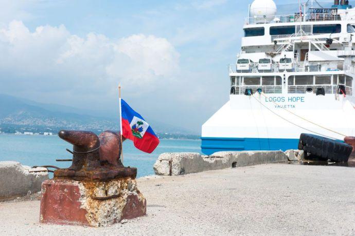 Haiti: Port-au-Prince, Haiti :: A Haitian flag flies at a mooring post near Logos Hopes berth. More Info