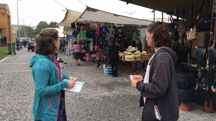 Portugal: Transform team members give out tracts at a local market in Portugal. More Info