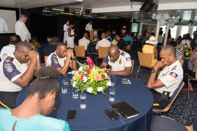 Haiti: Port-au-Prince, Haiti :: Crewmembers and participants pray during an event for business leaders. More Info