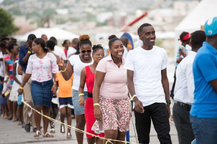 Haiti: Port-au-Prince, Haiti :: People queue to board Logos Hopes Visitor Experience Deck. More Info