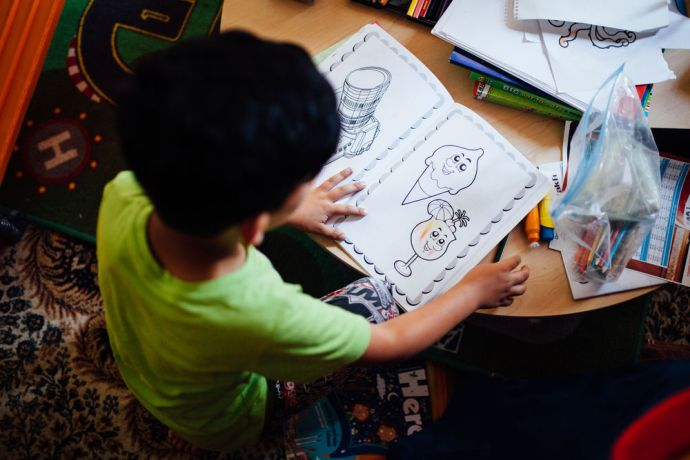 Turkey: Volunteers bring in donated colouring books for children to use during the weekly distributions at the refugee centre in Turkey. More Info
