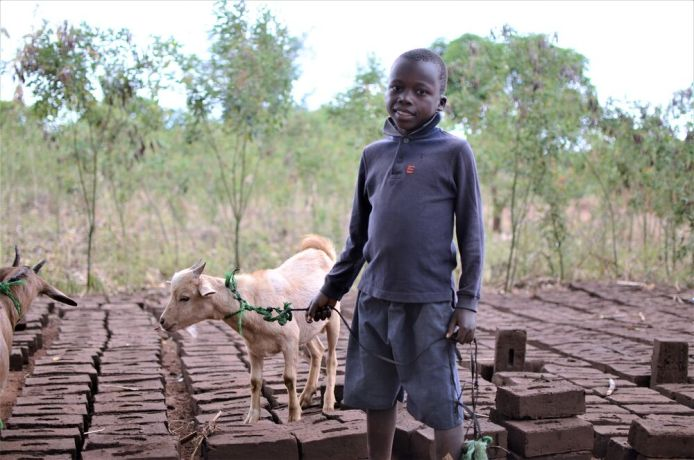 Malawi: A student at Chiyembekezo school in Ntaja shows off the goat he received from OM Malawi. More Info