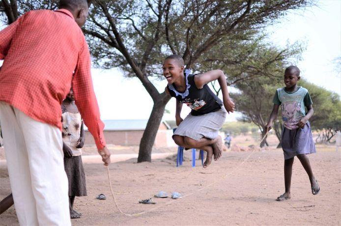 Tanzania: A girl jumping rope at Pastor Jacob Makoreres church in Bundu, Tanzania More Info
