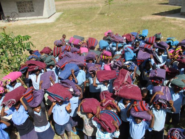 Malawi: Children of Chiyembekezo School receiving a blanket each to keep them warm during the cold nights during the winter More Info
