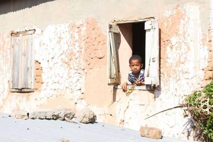 Madagascar: A boy looks out his window in Antananarivo, Madagascar. More Info
