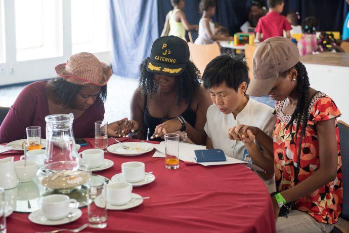 Haiti: (E) Port-au-Prince, Haiti :: Wan Li Haw (East Asia Pacific) prays for participants during an event for women on board. More Info