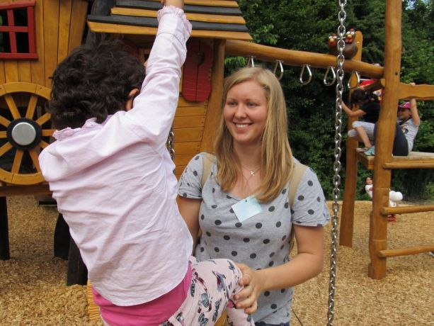 Austria: Trainee Rebekka from Building Bridges playing with immigrant children More Info