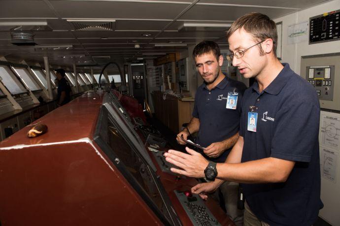 Dominican Republic: Santo Domingo, Dominican Republic :: Ionut Vlad (Romania) and James Berry (UK) plot the course the ship will take back to the port of Santo Domingo. More Info