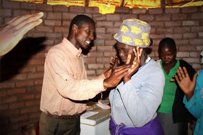 Zimbabwe: A woman is prayed for during an outreach to the least reached people in Cheredzi, a rural area in Zimbabwe. More Info
