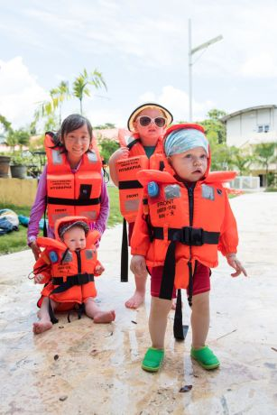Dominican Republic: Santo Domingo, Dominican Republic :: The youngest members of the September pre-ship training group don their lifejackets during basic safety training at a pool. More Info