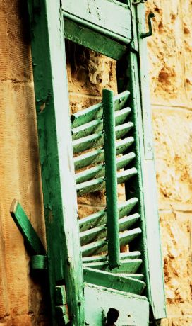 Israel: A crumbling window shutter tells the story of old homes of Israel. More Info