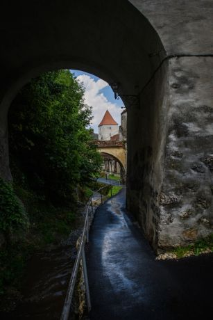 Romania: Light filters through to an alley in Brasov Romania.  Photo by Garrett N More Info