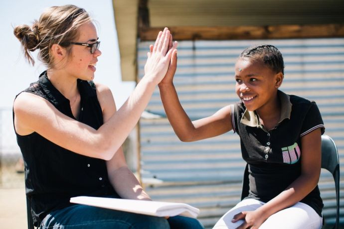 South Africa: High-five celebration after getting an answer correct. More Info