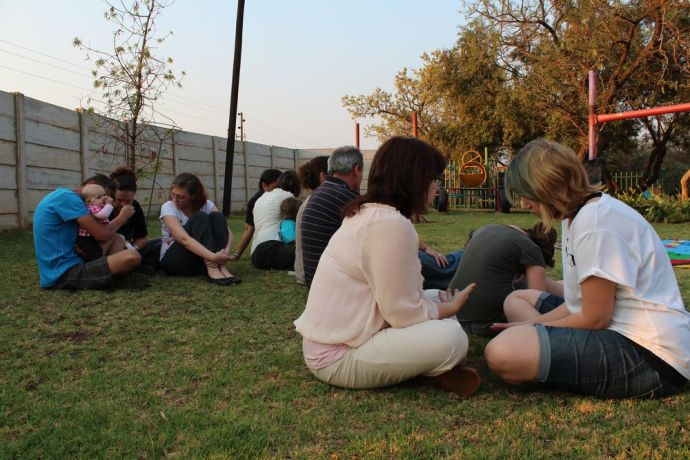 South Africa: Groups pray for each other. More Info
