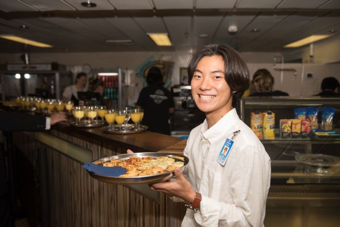 Saint Lucia: Castries, St. Lucia :: ChanMin Kang (South Korea) serves food to visitors at the official opening of the ship to the public. More Info