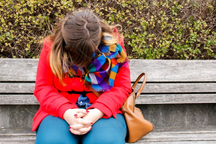 Switzerland: Woman prays on bench. More Info