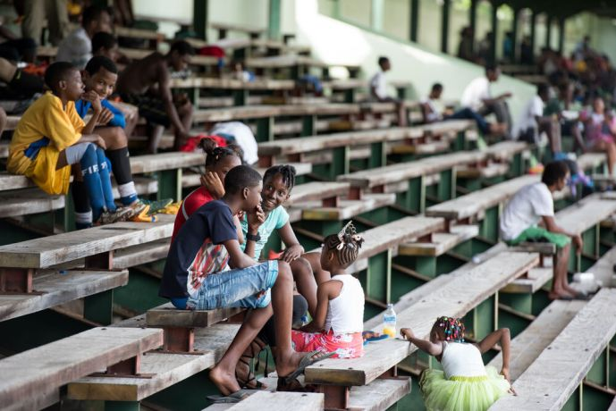 Saint Lucia: Castries, St. Lucia :: Spectators watch the football tournament. More Info