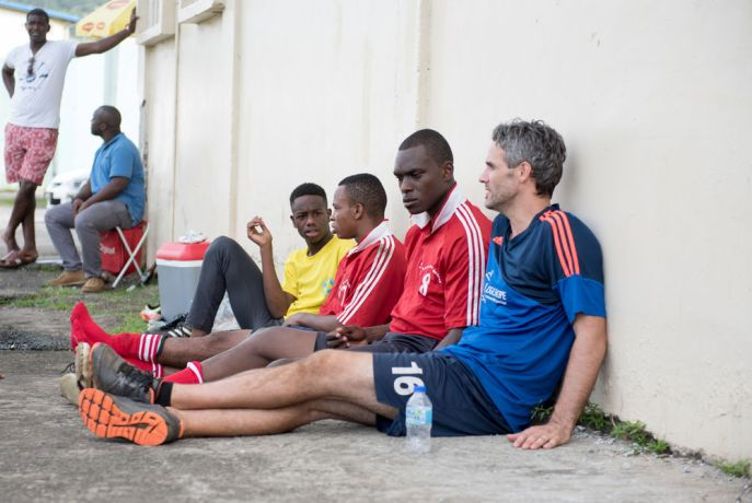 Saint Lucia: Castries, St. Lucia :: Luke Thomas (USA) talks to players at a football tournament. More Info