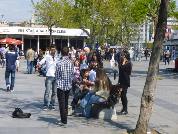 Turkey: In an open area in Istanbul people wander past or gather in groups. More Info