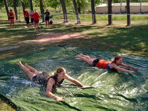 Hungary: American coaches and Hungarian softball players enjoy a slip-n-slide during a softball camp put on by OM and FCA in summer 2017. More Info