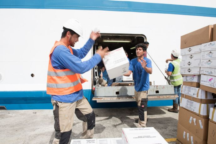 Barbados: Bridgetown, Barbados :: Crewmembers load boxes through the shell door. More Info