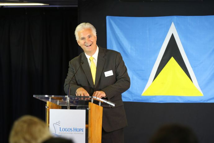 Saint Lucia: Castries, St. Lucia :: Randy Grebe (USA) talks about the flag of St. Lucia during the official opening. More Info