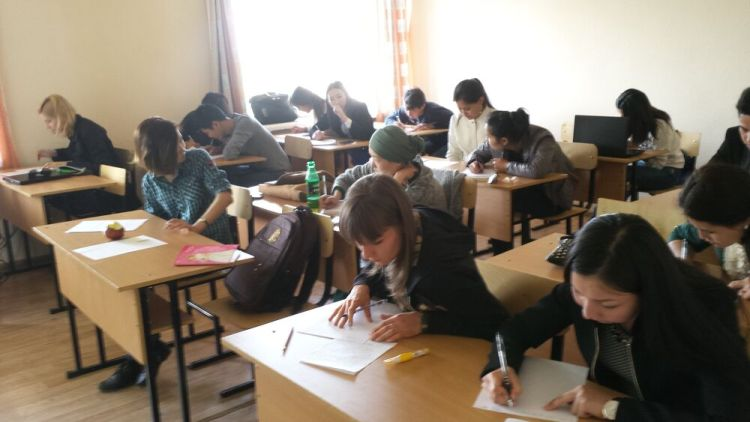 Central Asia: Central Asian university students working at their desks in a classroom More Info