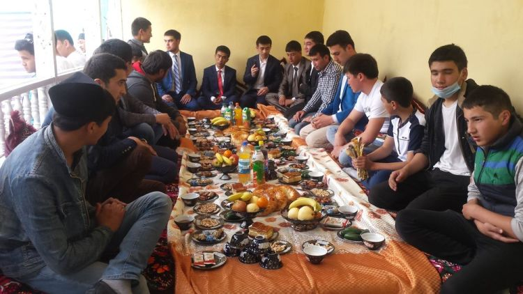Central Asia: Young men sit on the floor with the groom at a typical Central Asian banquet. More Info