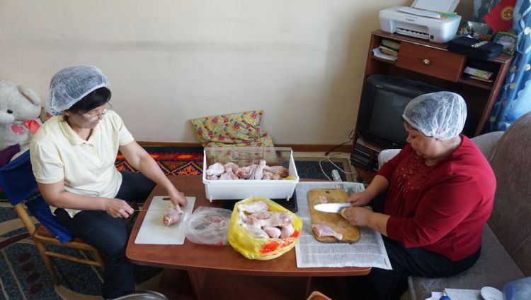 Central Asia: Central Asian women preparing chicken More Info