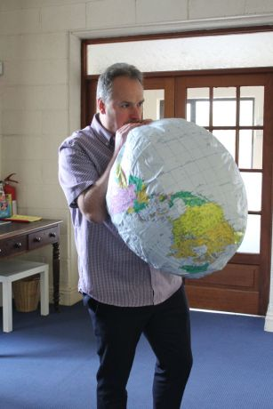 Ireland: OM Ireland National Director Alastair Kerr inflates the globe for George Verwer More Info