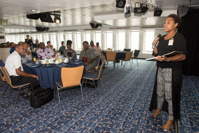 Barbados: Bridgetown, Barbados :: Allison Millington (Barbados) speaks to participants during an event on board. More Info