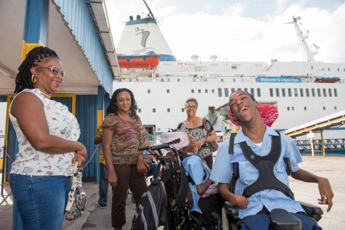 Barbados: Bridgetown, Barbados :: Disabled students and their carers wait for the bookfair to open. More Info