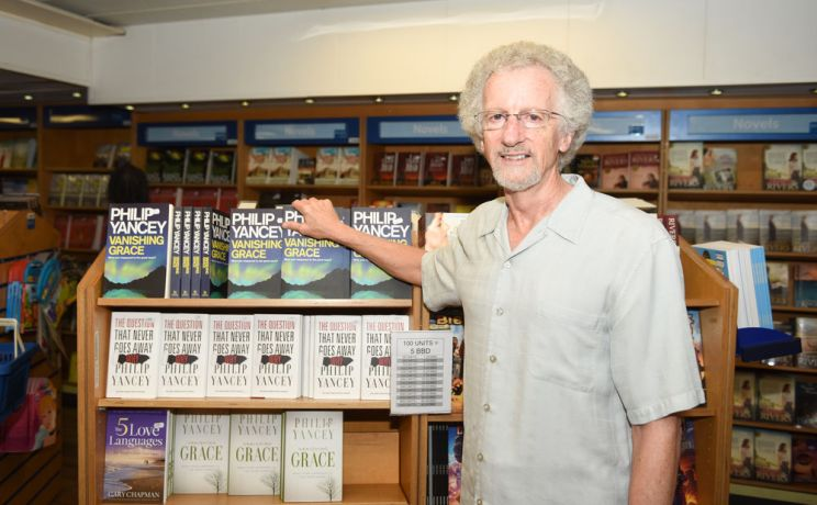 Barbados: Bridgetown, Barbados :: Author Philip Yancey with copies of his books in Logos Hopes bookfair. More Info