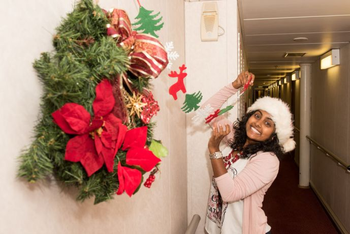 Saint Vincent & the Grenadines: Kingstown, St. Vincent and Grenadines :: Malerie Pillay (South Africa) hangs Christmas decorations on board Logos Hope. More Info