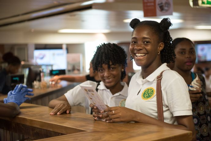 Saint Vincent & the Grenadines: Kingstown, St. Vincent and Grenadines :: Schoolchildren choose from the menu in Logos Hopes International Cafe. More Info
