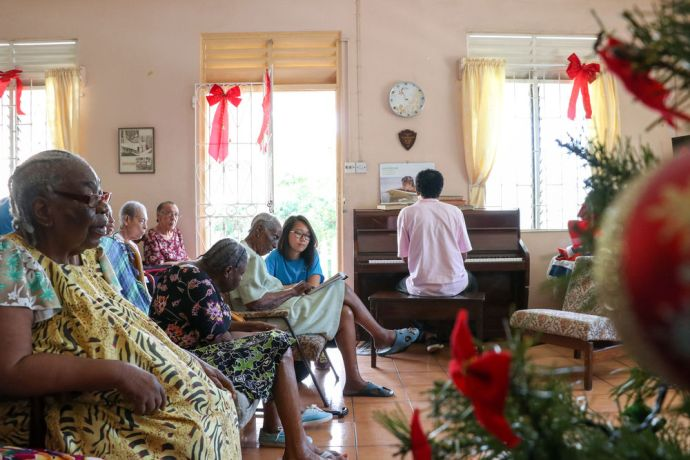 Saint Vincent & the Grenadines: Kingstown, St. Vincent and Grenadines :: Crewmembers sing songs alongside people in a home for elderly people. More Info