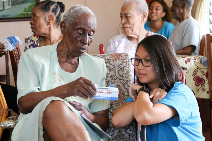 Saint Vincent & the Grenadines: Kingstown, St. Vincent and Grenadines :: Crewmembers help residents at a care home make models of Logos Hope. More Info